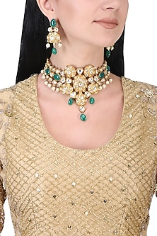 Gold plated kundan and green beads necklace set by AURAA TRENDS