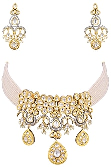 Gold plated kundan and pearl choker necklace set by AURAA TRENDS