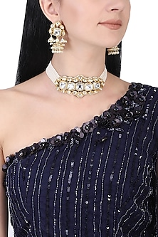 Gold plated white kundan and pearl choker necklace set by AURAA TRENDS