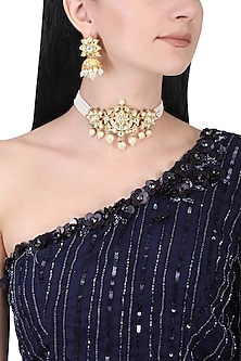 Gold plated kundan and white pearl choker necklace set by AURAA TRENDS