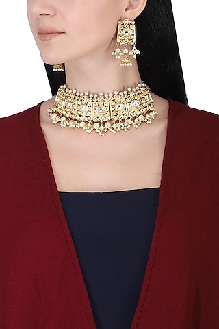 Gold plated kundan and pearl beads choker necklace set by AURAA TRENDS