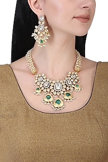 Gold plated kundan, green beads and pearl necklace set by AURAA TRENDS