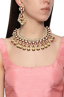 Gold plated kundan and red meena necklace set by Auraa Trends