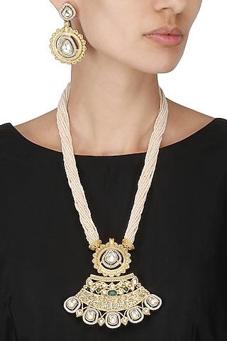 Antique Gold Finish Kundan Studded Pendant Set by Auraa Trends