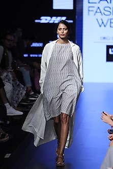 Multicolor print white base silk trench coat by Aartivijay Gupta