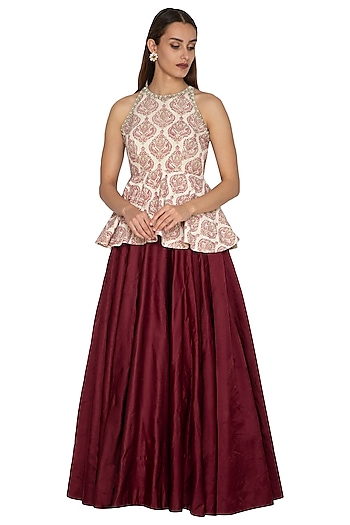 Ivory Embroidered Peplum Top With Maroon Skirt by Bhumika Sharma