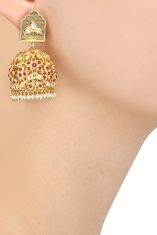 Gold Plated Red Stone Studded Jhumka Earrings by Blue Turban