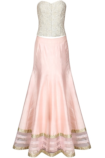 Powder pink sequins embroidered lehenga and ivory beaded corset set by Cherie D