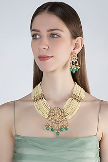 Gold Finish Green Stone Necklace Set by Chhavi's Jewels