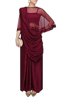 Oxblood satin sari with floral embroidered cape by Chhavvi Aggarwal