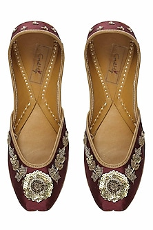 Deep maroon and gold floral zardozi embroidered juttis by Coral Haze