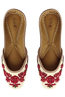 Light gold and red floral embroidered juttis by Coral Haze