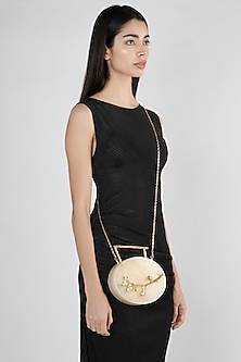 Beige Metal Embellished Oval Clutch by A Clutch Story