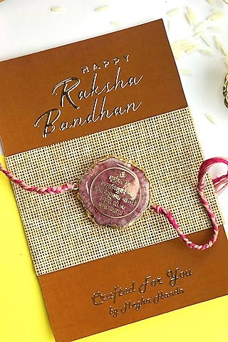 Pink Rakhi With Embedded Gayatri Mantra by  Crafted For You by Megha Handa