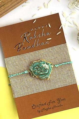 Green Rakhi With Embedded Gayatri Mantra by  Crafted For You by Megha Handa