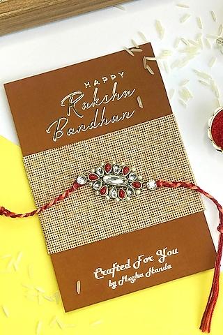Red Kundan Polki Rakhi by  Crafted For You by Megha Handa