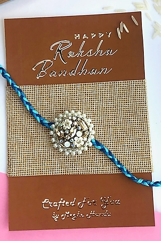 White & Copper Acrylic Flower Rakhi by  Crafted For You by Megha Handa