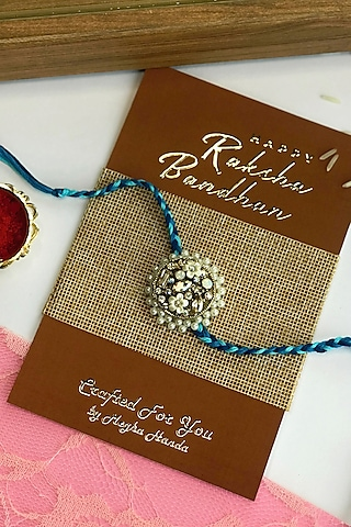 White Glass Stone Rakhi by  Crafted For You by Megha Handa