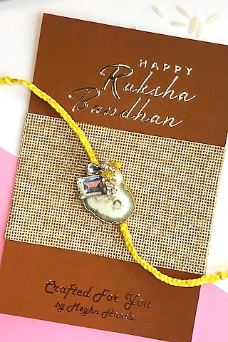 White & Yellow Rhinestone Rakhi by  Crafted For You by Megha Handa