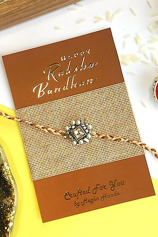 Copper & White Micro Pearl Rakhi by  Crafted For You by Megha Handa