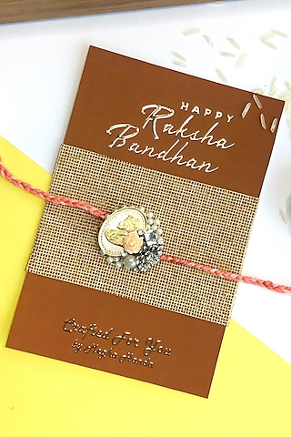 Pure Silver Coin Rakhi With Pearls by  Crafted For You by Megha Handa