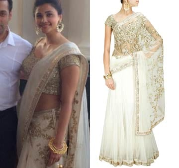 White zardozi lehenga sari with fully embroidered blouse piece by Sabyasachi
