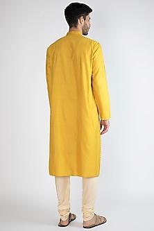 Yellow Pintex Kurta With Churidar Pants by Devanshi Didwania