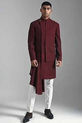 Maroon Layered Sherwani With White Trousers by Dhruv Vaish