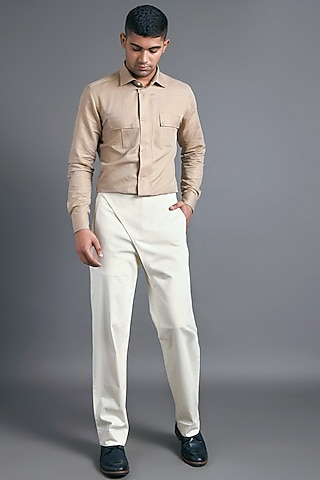 Cream Trousers With Flap Closure by Dhruv Vaish