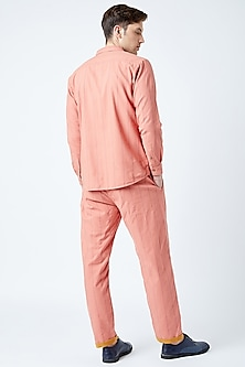 Peach Printed & Embroidered Pants by Doodlage Men