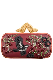 Red embroidered clutch bag by Duet Luxury