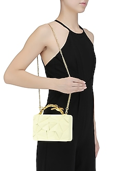Cream Asymmetric Grasshopper Clutch by Duet Luxury