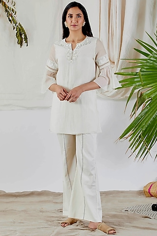 White Beads Embroidered Top by Devyani Mehrotra