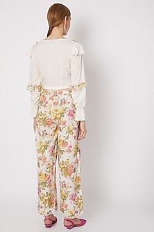 Yellow Floral Printed Pants by Dilnaz Karbhary