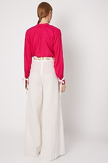 White Pleated Flared Pants With Belt by Dilnaz Karbhary