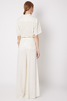 White & Yellow Pleated Pants With Belt by Dilnaz Karbhary