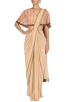 Peach hand embroidred cape and drape saree set by Dheeru and Nitika