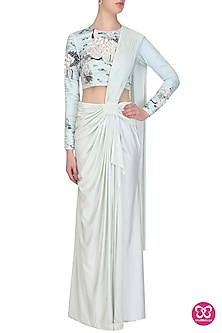 Aqua pleated lycra saree with birds embroidered blouse by Eshaani Jayaswal