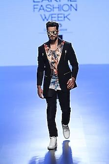 Black Coat, Trouser Pants And Multi Coloured Fish Photoreal Vest by Farah Sanjana