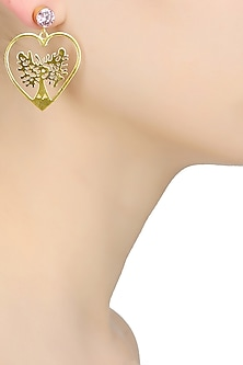 Gold finish heart cut out earrings by Finura By Richa