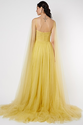 Yellow Flared Net Gown by Gauri And Nainika