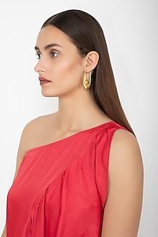Gold Finish Horseshoe Shaped Earrings by Gauri Himatsingka