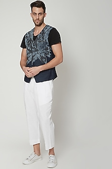 White Pleated Trousers by Genes Lecoanet Hemant Men