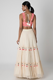 Off White & Fluorescent Pink Tiered Lehenga Set by Sounia Gohil