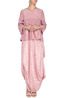 Pink embroidered bandhani drape with overlayer top and churidar by Garo