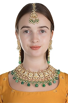 Gold Finish Green Onyx Shehzaadi Necklace Set With Maang Tikka by HEMA KHASTURI LABEL