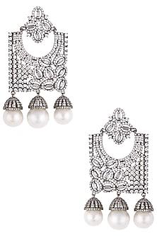 Rhodium plated diamond and pearl geometrical dangler earrings by HEMA KHASTURI LABEL