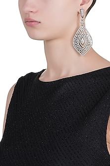 Rhodium plated antique finished diamond dangler earrings by HEMA KHASTURI LABEL