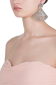Rhodium plated diamond fan shaped dangler earrings by HEMA KHASTURI LABEL