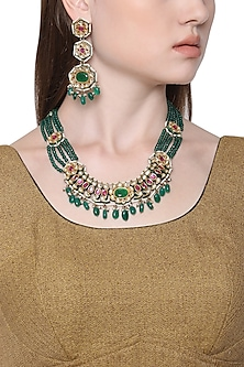 Gold Plated Kundan and Green Stone Drops Necklace with Tiered Earrings by HEMA KHASTURI LABEL